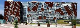 """Cartel con vista frontal del Edificio de la Biblioteca Público de Estado de Jalisco """"Juan José Arreola"""""""